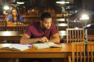 OLSAT 8 - student studying at a library