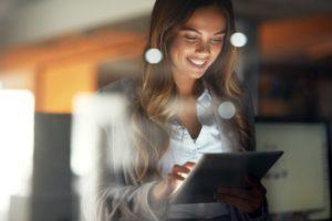 University of Missouri Qualtrics Test - woman on iPad smiling